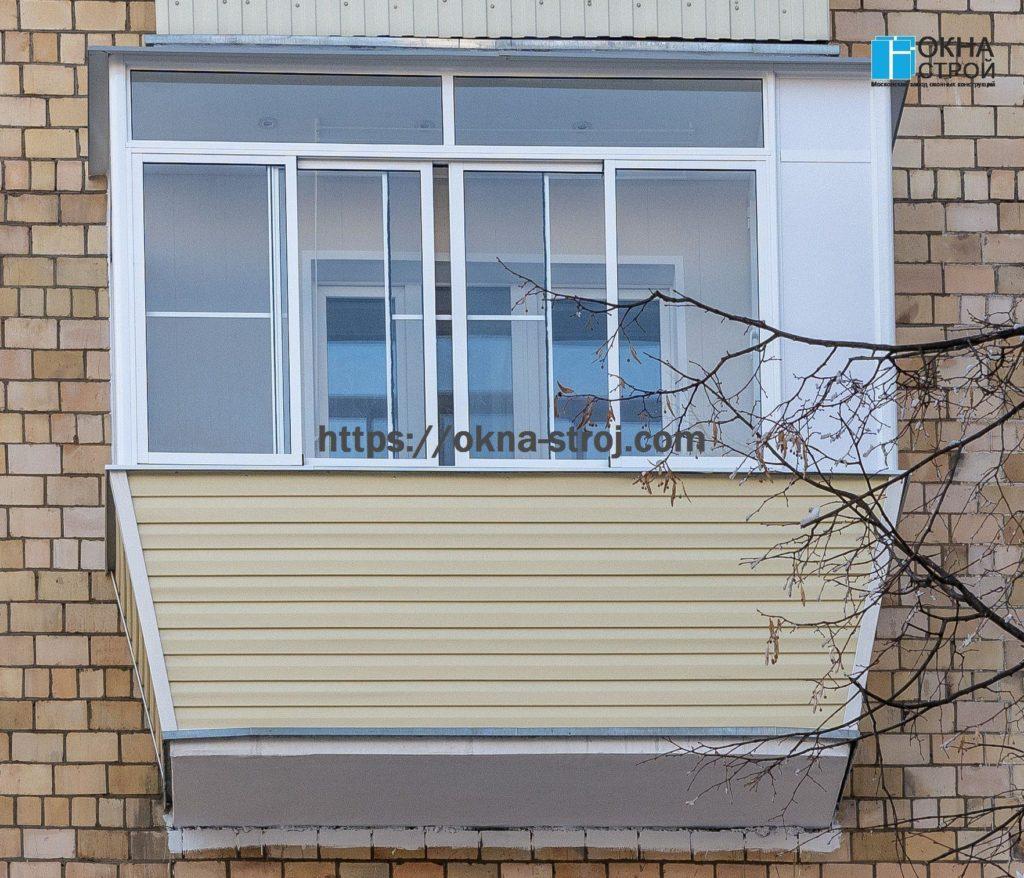 Балкон в сталинском доме с выносом по подоконнику, вид снаружи